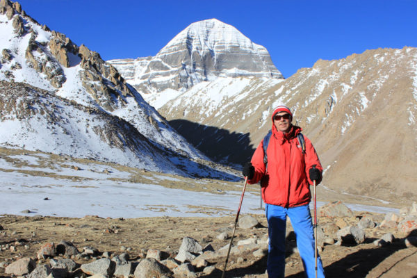 Traveler taking picture infront of Mount Kailash