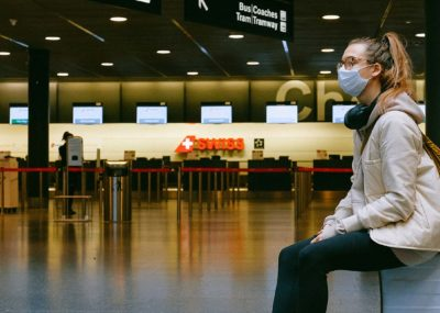 Traveler at the airport during global pandemic; travel safely during Covid-19